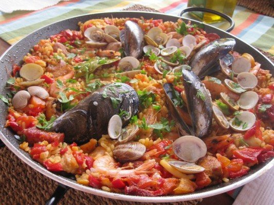 traditional seafood paella in pan