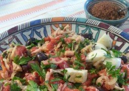 tuna salad with egg, olives and peppers